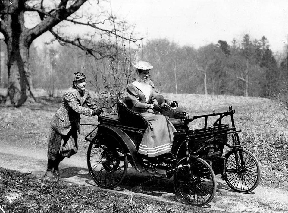 Man pushing car Photographer: William Jamesca. 1900