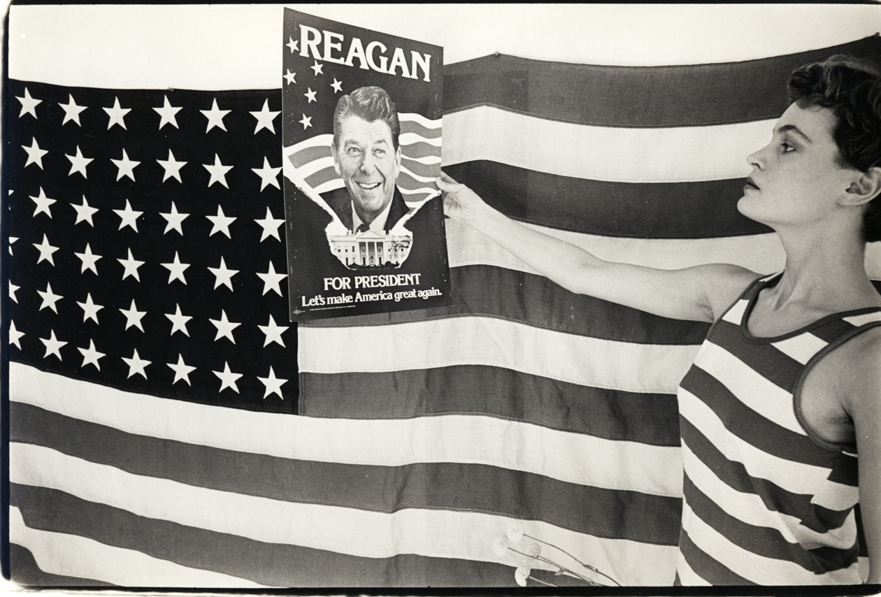 Mary Boochever, with Reagan Poster, Chinatown, 1980
