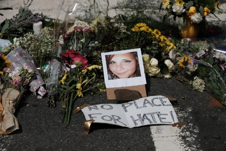 Flowers and a photo of car ramming victim Heather Heyer lie at a makeshift memoriall in Charlottesville