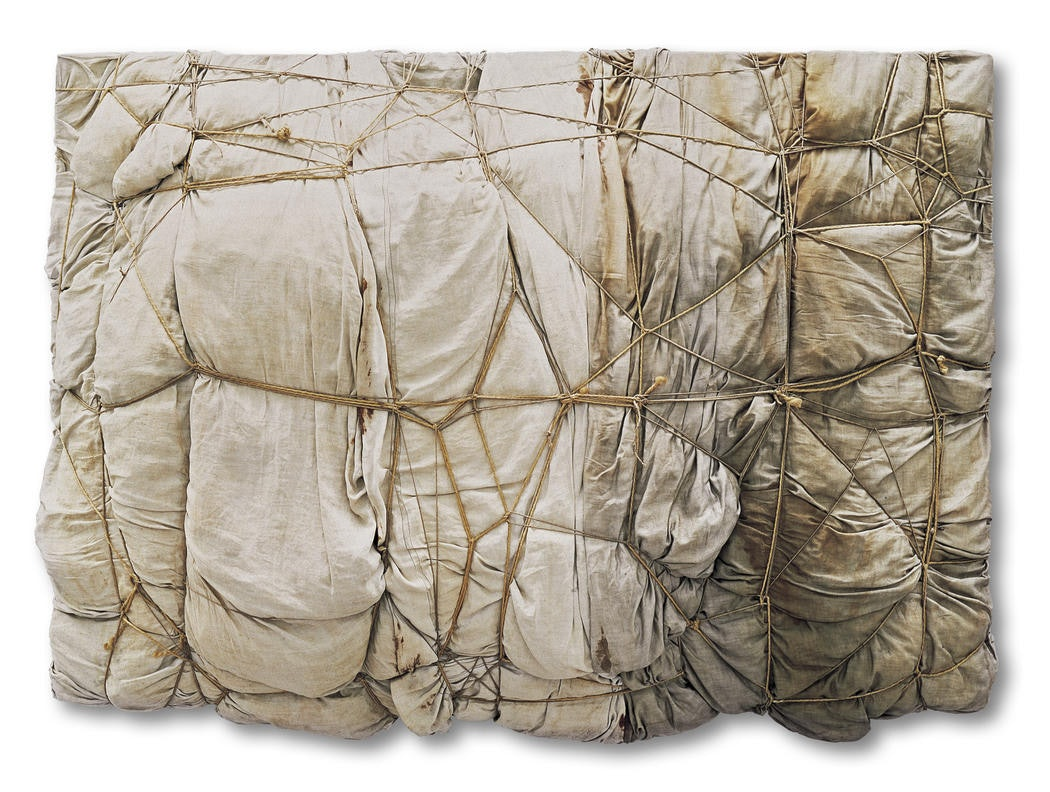 Christo Package 1961 Fabric and ropes on board 51 1:4 x 70 7:8 x 13 (130 x 180 x 33 cm) Kröller-Müller Museum, Ottlerlo, The Netherlands Photo- Kröller-Müller Museum © 1961 Christo