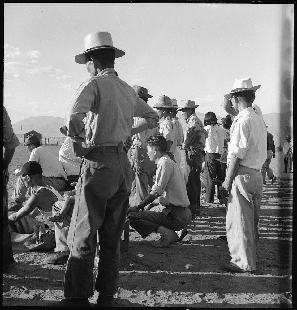 dorothea_lang_Manzanar_Relocation_Center,_Manzanar,_California._Evacuees_of_Japanese_ancestry_are_enjoying_a_base_._._._-_NARA_-_538067