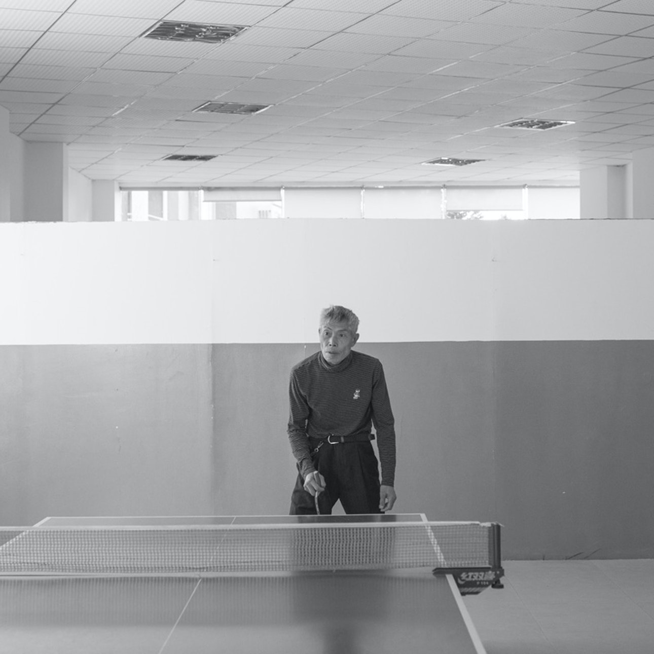 An officer enjoys a game of table tennis.