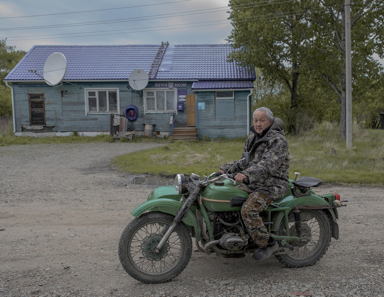 A resident of Naikhin pictured outside the Post Office