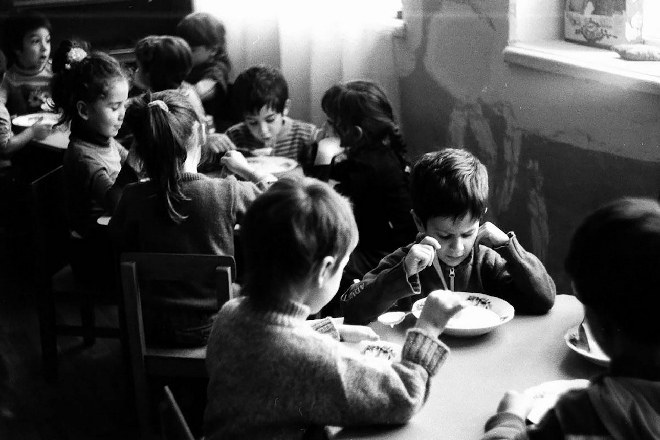 Kids having soup for lunch. Tbilisi, Georgia, 2010